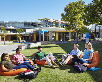Students sitting on bean bags outside at Joondalup Campus