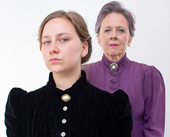 Two actors playing the role of Edith Cowan in a play about her life.